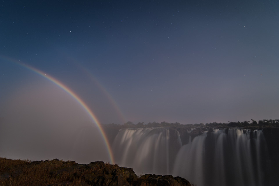 A rainbow adds to the glow of a blue moon at Victoria Falls, Zimbabwe ©Brina Bunt