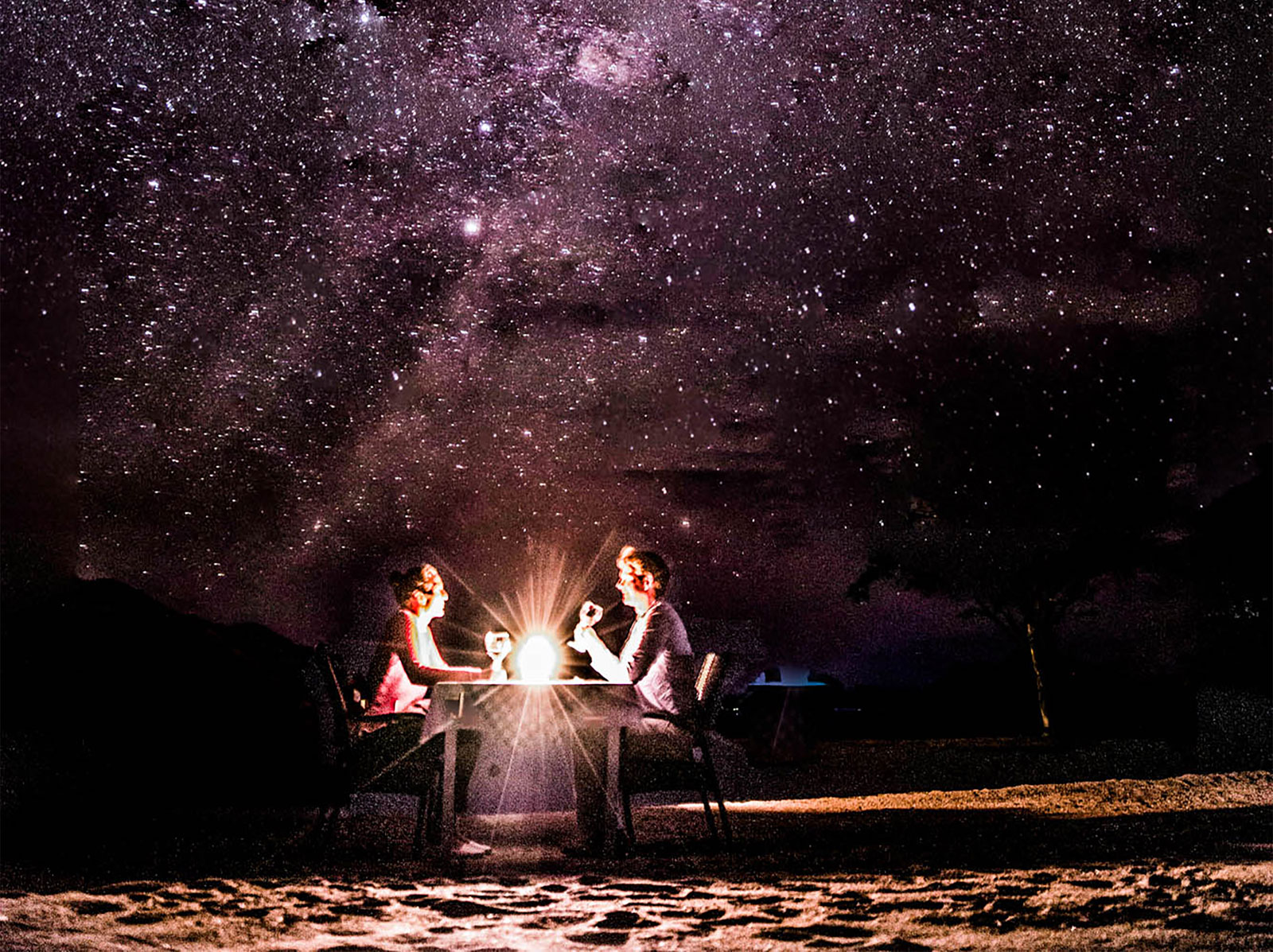"Dining under the stars ©<a href=http://www.robinpopesafaris.net/camps/pumulani.php/ target=""_blank"">Robin Pope Safaris</a>"