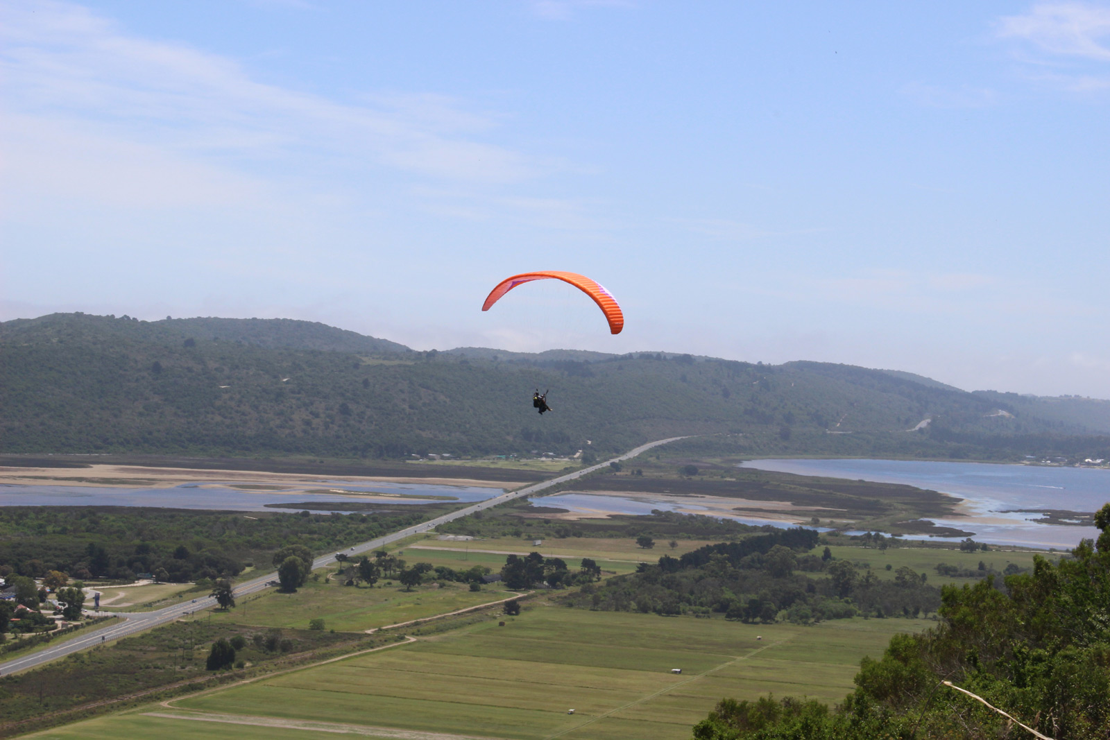 "Fly like a bird with <a href=""http://www.altitudeparagliding.com"" target=""_blank"">Altitude Paragliding</a> ©David Winch"