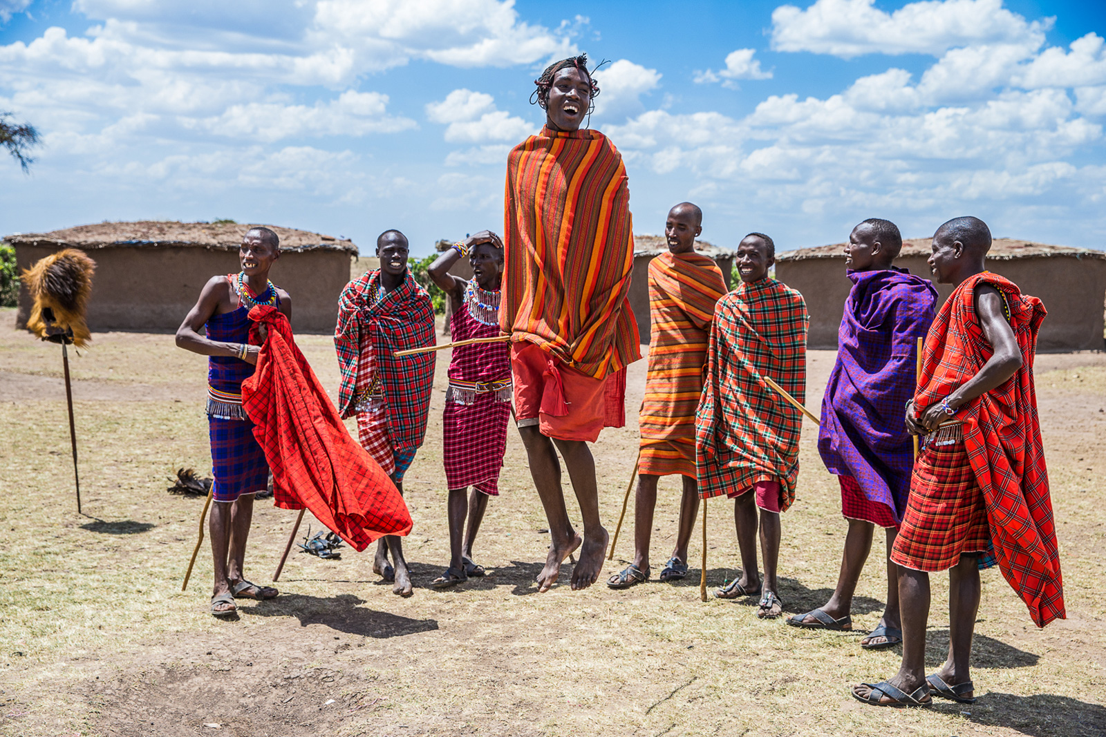 Maasai warriors perform their famous jumping dance in Maasai Mara, Kenya ©Kim Roslev