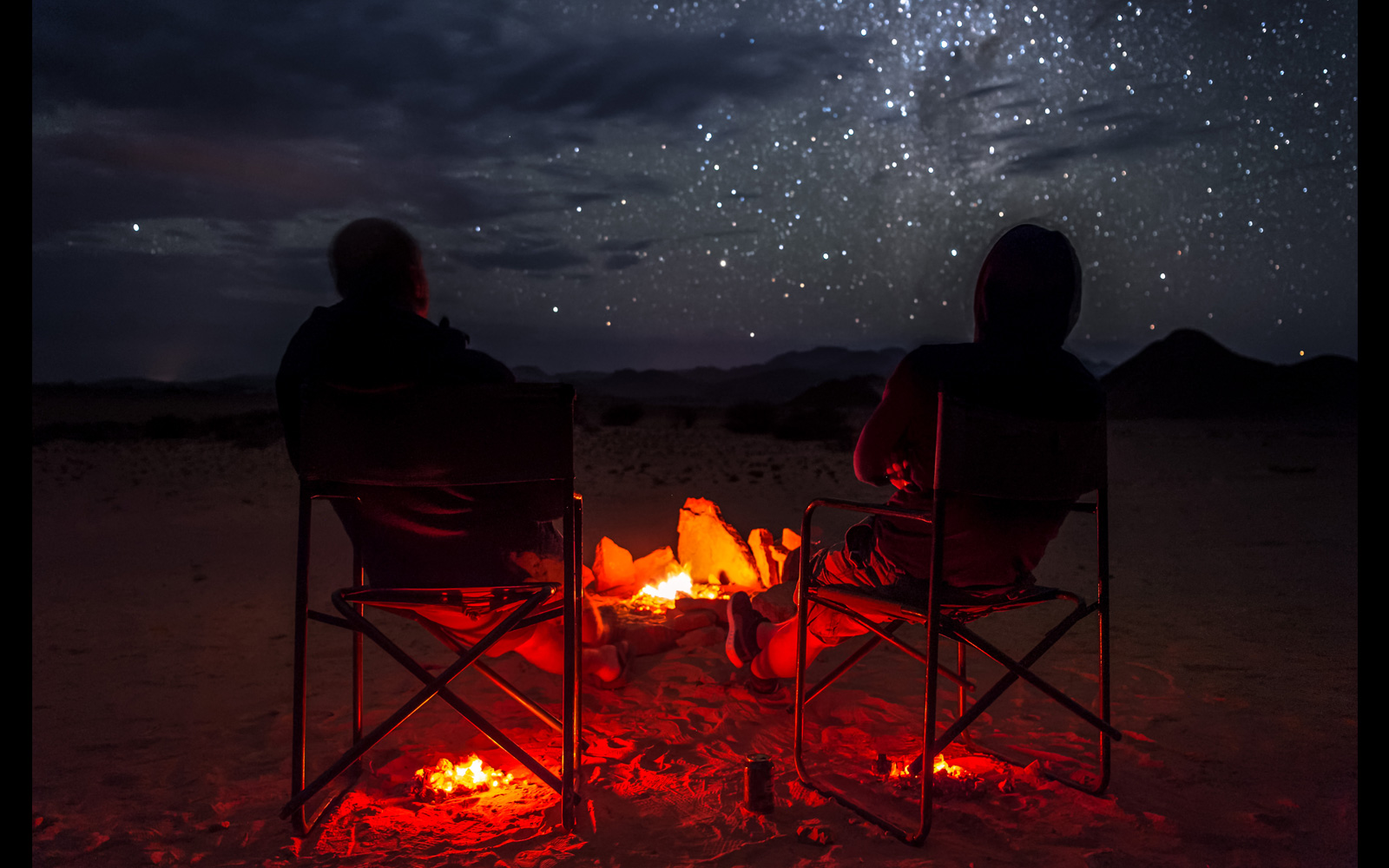 """Starry night with heated seats"" in Desolation Valley along the Huab River, Namibia © Denis Roschlau"