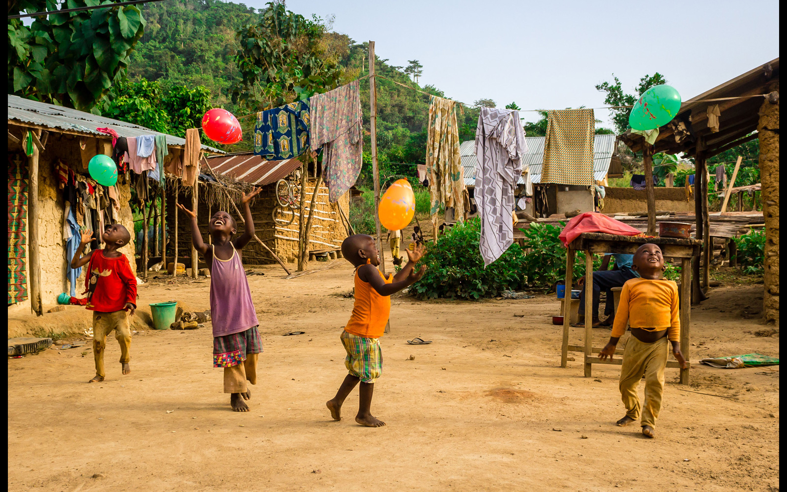 A group of children playing with balloons for the first time in their lives, Bibiani, Ghana © Karel Haal