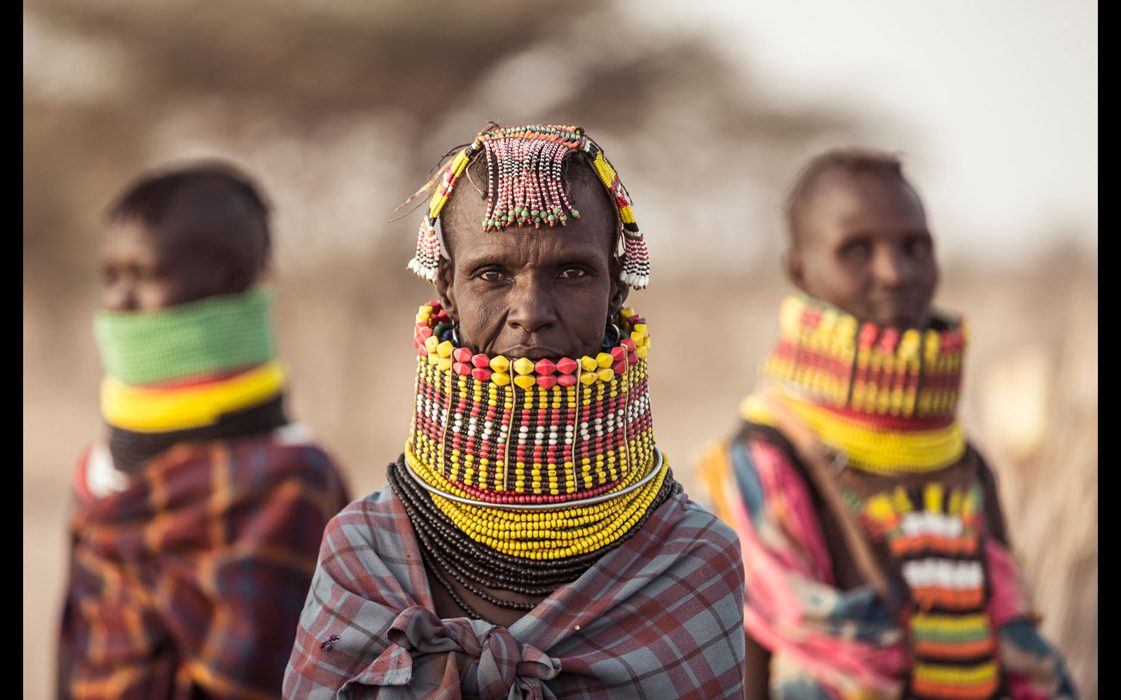 "Three Turkana tribeswomen wearing traditional necklaces © <a href=""https://content.notesfromtheroad.ch/turkana-cradle-of-mankind/"" target=""_blank""> Joe Bürgi </a>"