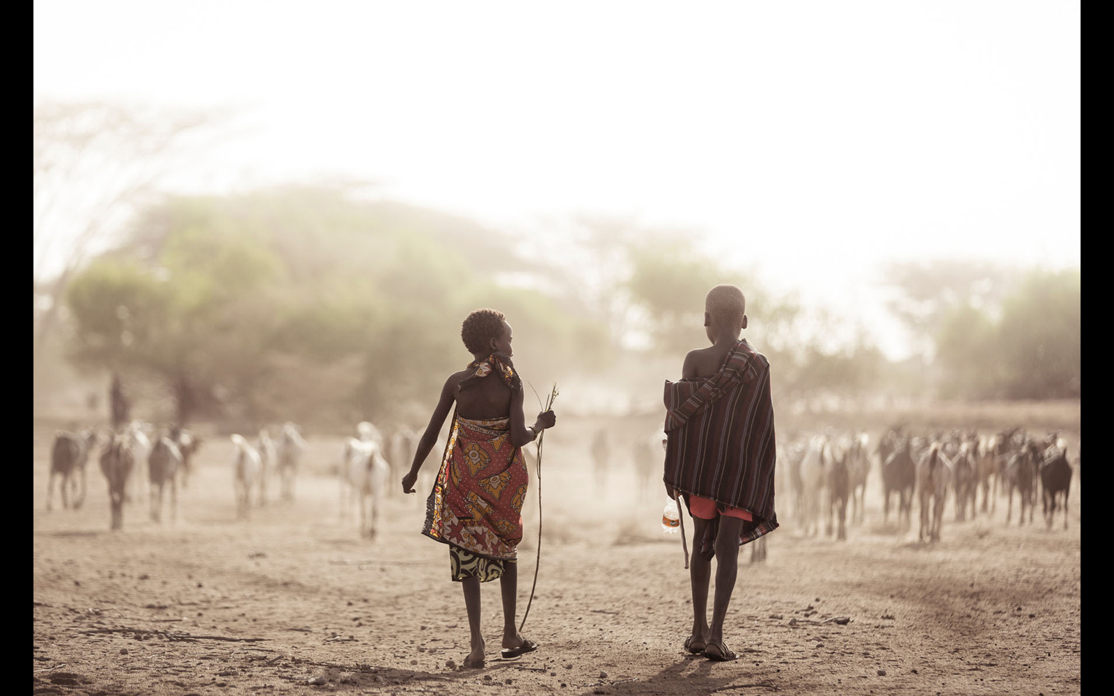 "Young herders with their goats, making their way to a nearby waterhole early in the morning © <a href=""https://content.notesfromtheroad.ch/turkana-cradle-of-mankind/"" target=""_blank""> Joe Bürgi </a>"