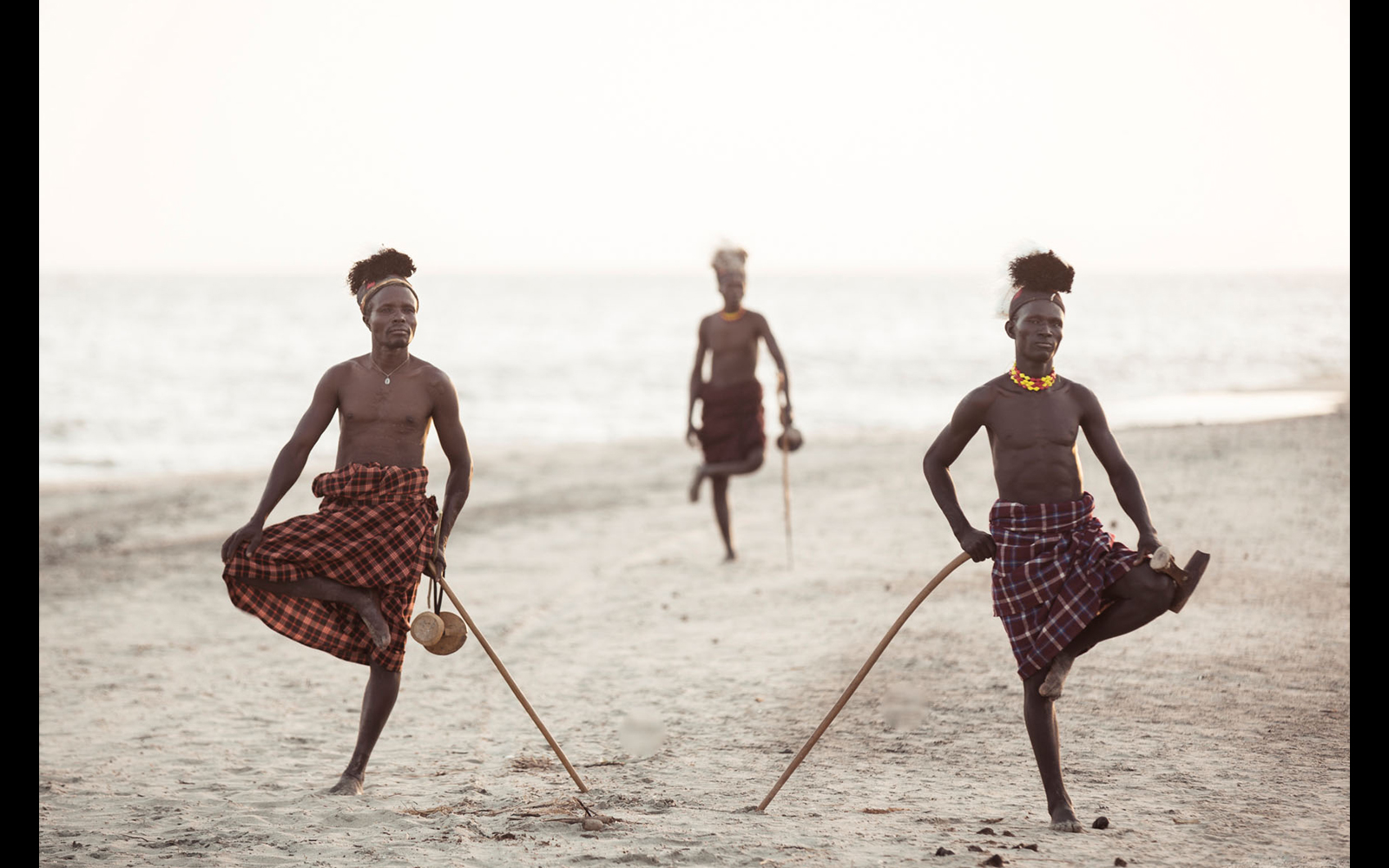 "Turkana tribesmen standing Turkana-style, on the shores of Lake Turkana © <a href=""https://content.notesfromtheroad.ch/turkana-cradle-of-mankind/"" target=""_blank""> Joe Bürgi </a>"