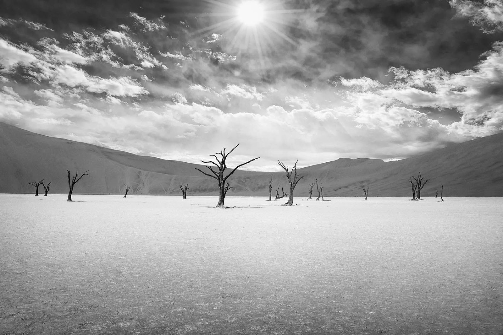 The boiling sun rising over the dead trees of Sossusvlei, Namibia ©Björn Persson