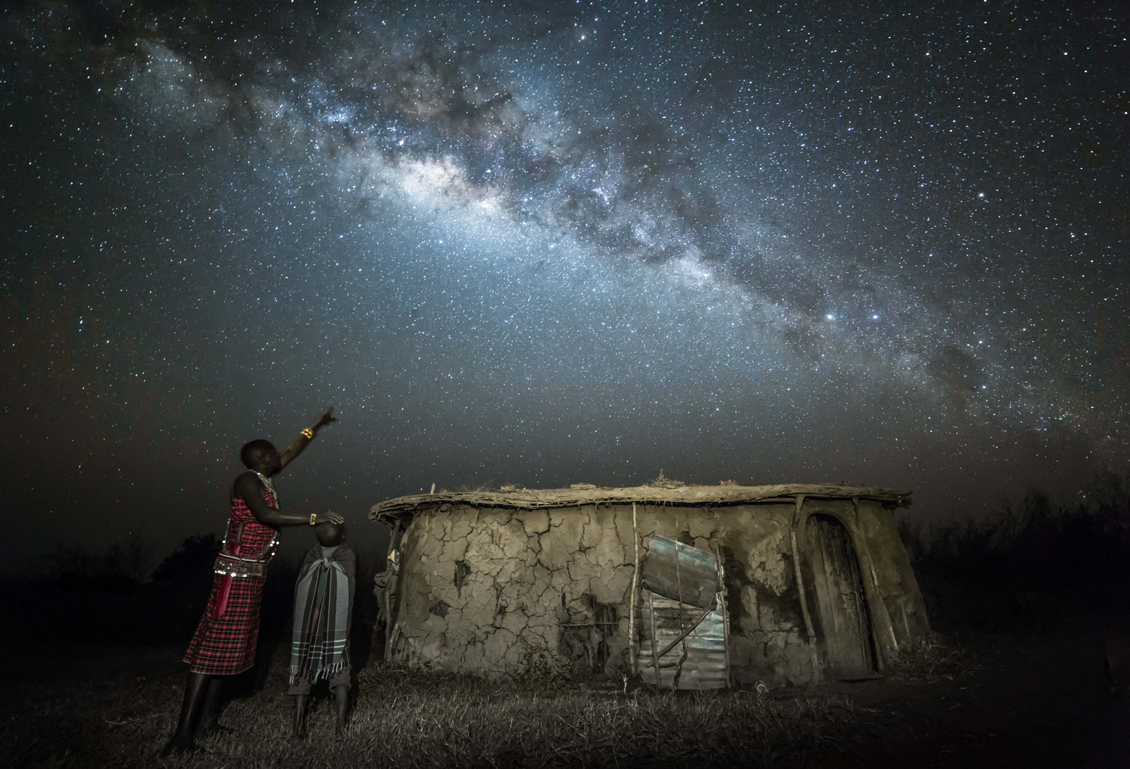 A Maasai warrior teaches his son about the stars ©Robin Stuart