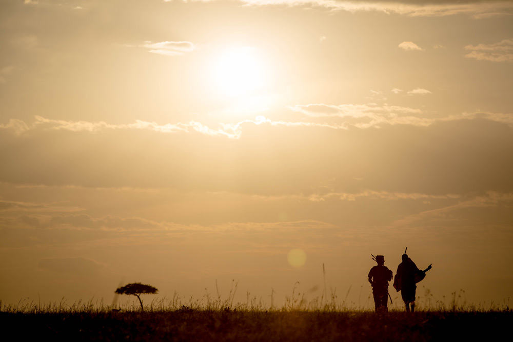 sunset-silhouette-walking-maasai-stuart-price-make-it-kenya