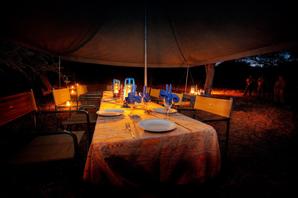 mobile camp safari, dining area, tables and chairs, Africa