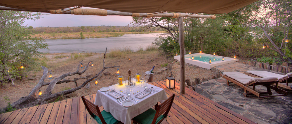 Safari tent accommodation on the bank of a river
