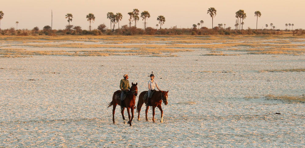 Riding on horseback across the salt pans