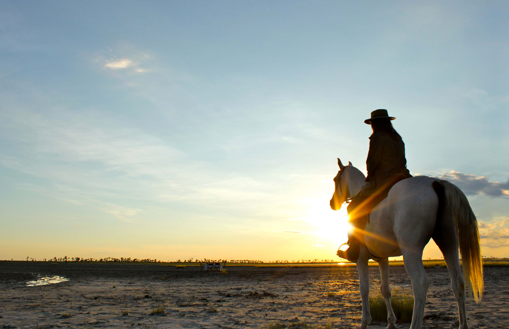 Sitting on horseback watching the sunrise