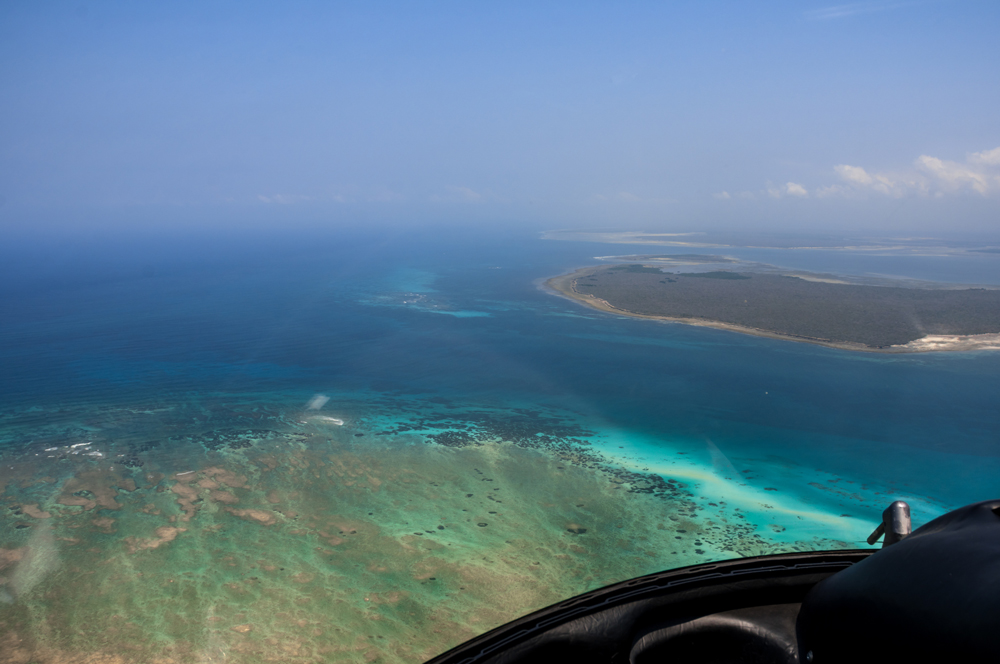 Aerial view from a helicopter of Quilalea island and Mainland Mozambique