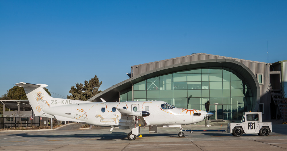 A private jet outside a hangar