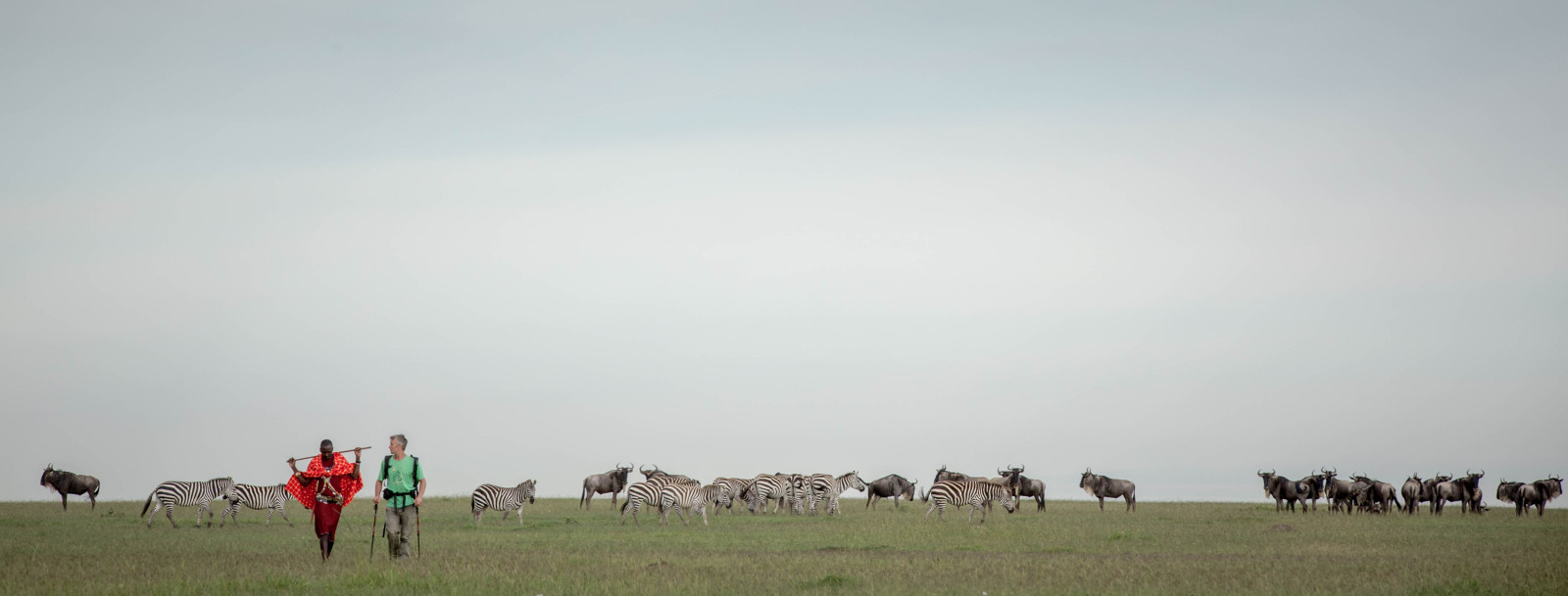 Stuart Butler and his Maasai companion, Josphat Mako, walk through the region that is famed for its great migration ©Stuart Price