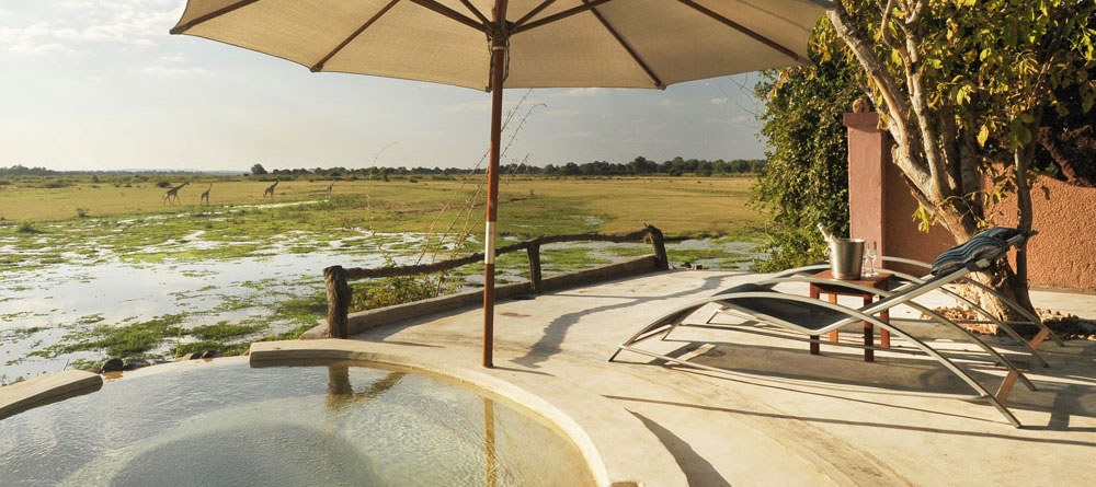 The fabulous hot tub at Kafunta River Lodge, fed by a natural hot spring and looking out over the game rich floodplain.