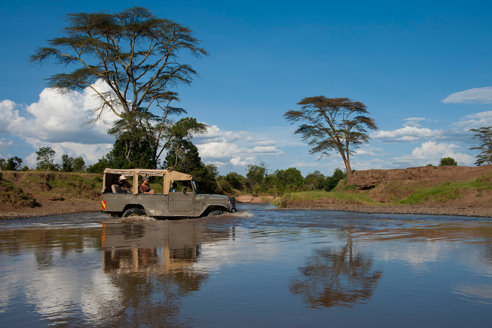 A safari vehicle crossing a river in Ol Pejeta conservancy