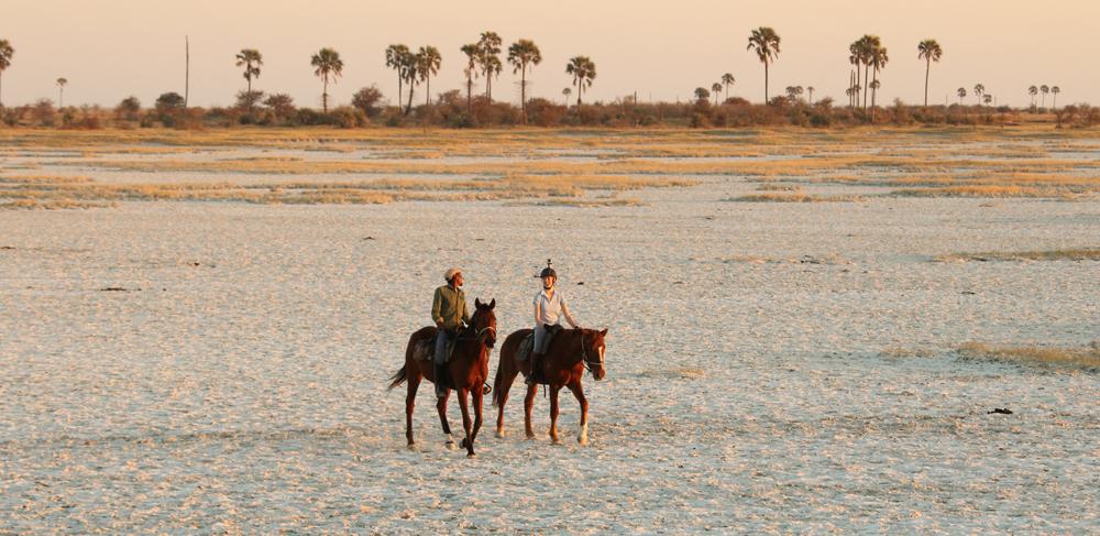Riding on horseback across the salt pans