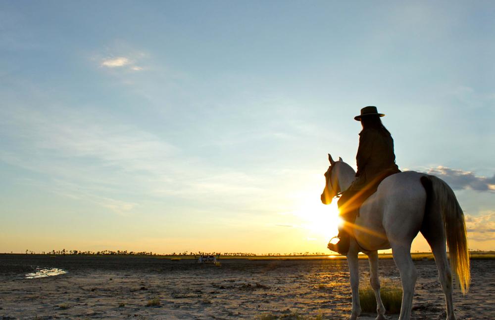 Sitting on horseback watching the sunrise