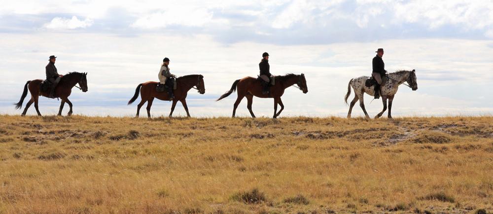 Riding across the grassy plains of the Makgadikgadi savannah