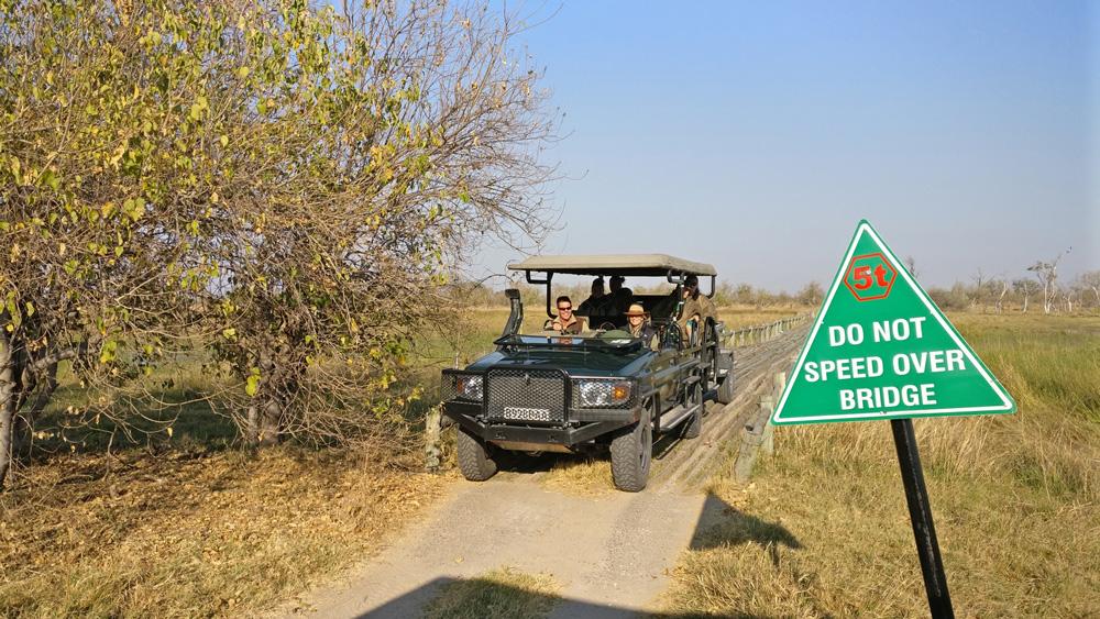 Safari vehicle driving over a bridge