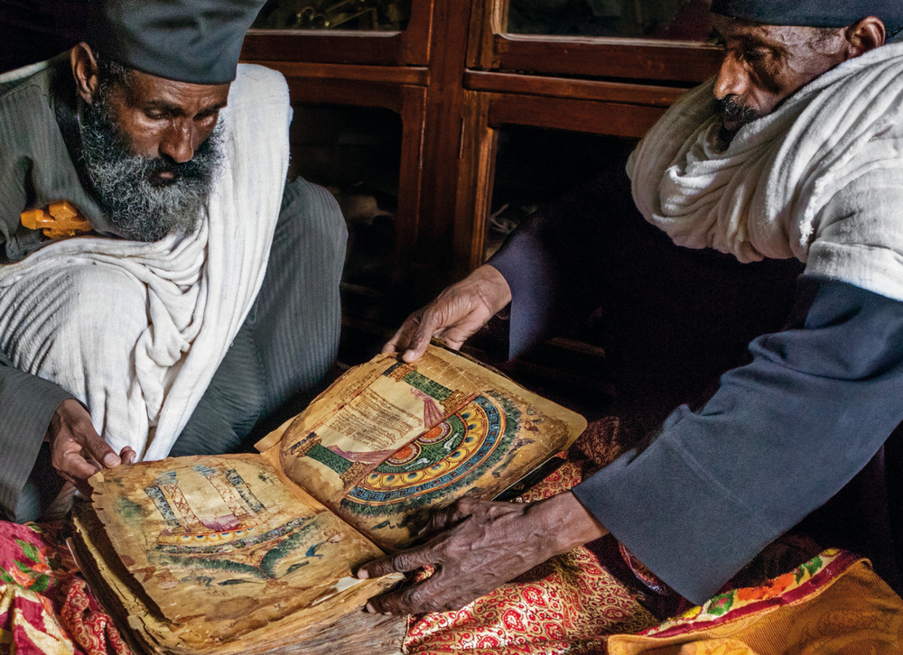 Senior monk and abbot with an ancient manuscript