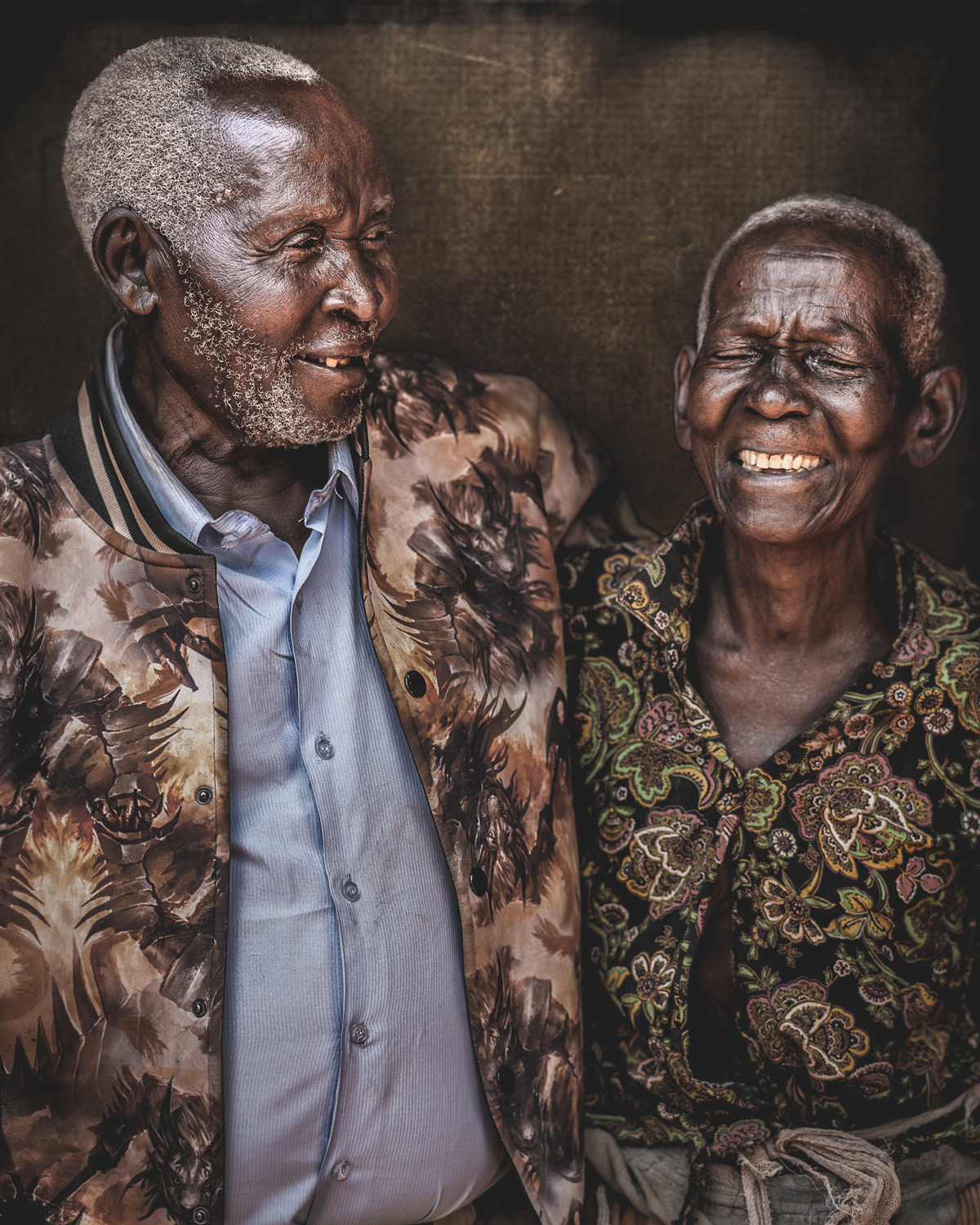 Mzee (100) poses with his wife (90) for a portrait in Jinja, Uganda © Bob Ditty