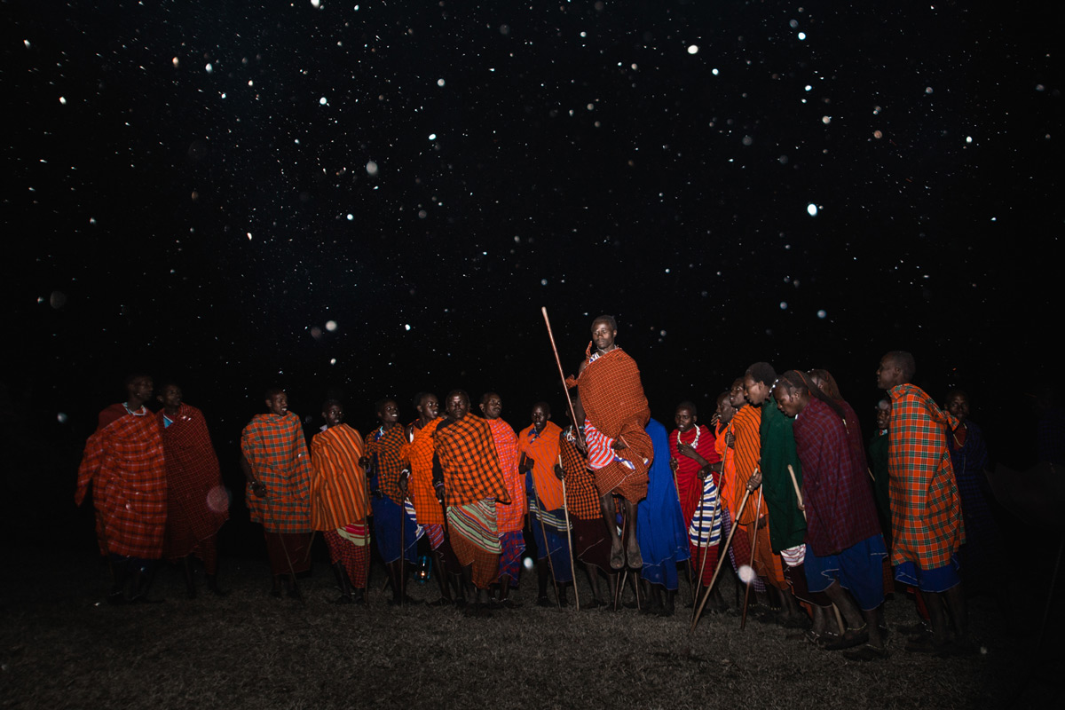 """Reach for the stars"" – Masaai warriors performing their traditional dance, Ngorongoro Crater, Tanzania © Caleb Shepard"
