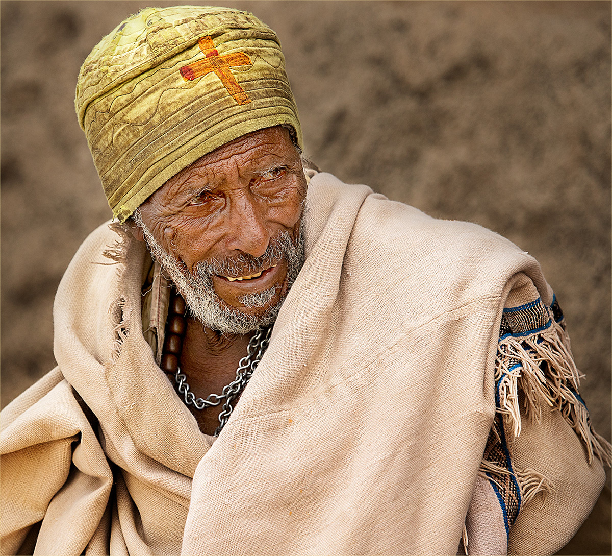 An old man in his church clothes on his way to church, Lalibela, Ethiopia © Hesté de Beer