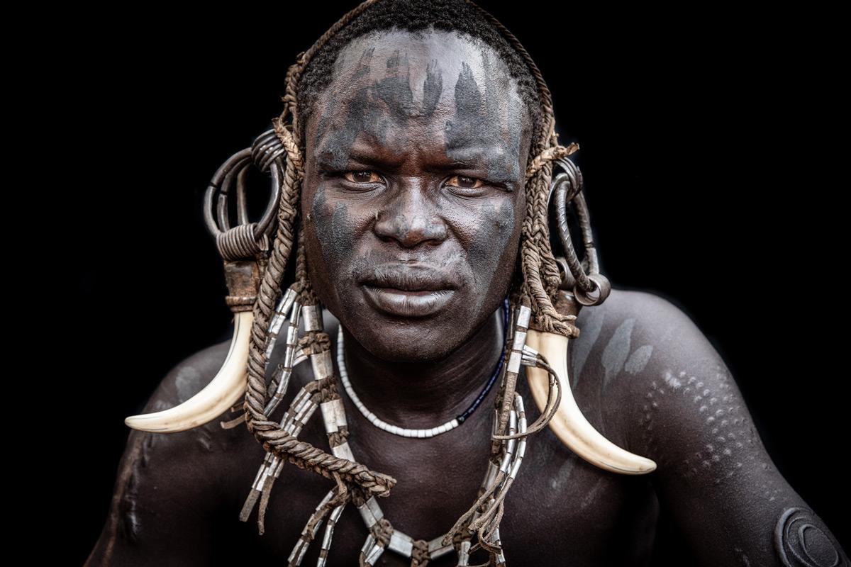 Portrait of a Mursi tribesman in Omo Valley, Ethiopia © Janet Regan
