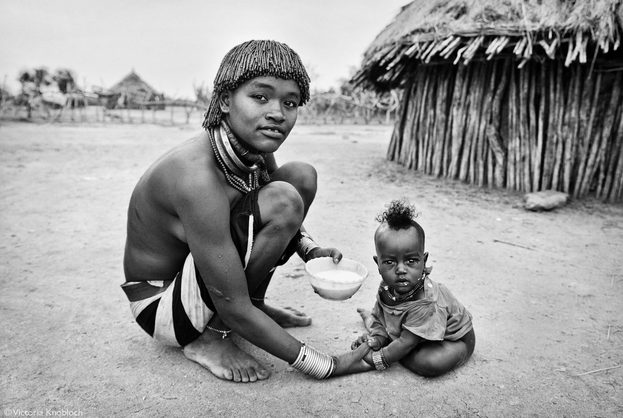 Hamer tribe mother feeding her child, Omo Valley, Ethiopia