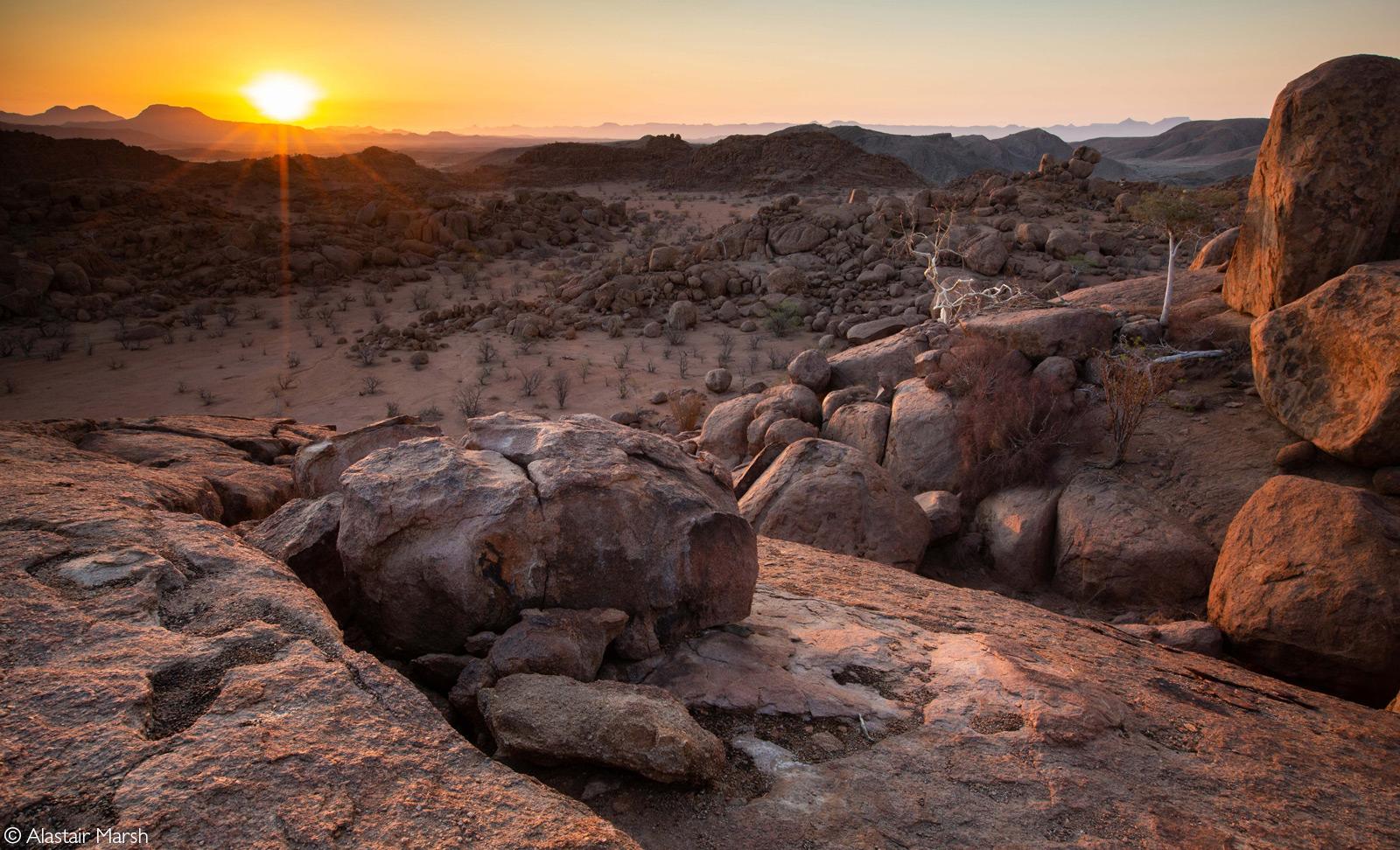 Sunset across the Namib Desert from Mowani Mountain Camp. Damaraland, Namibia © Alastair Marsh