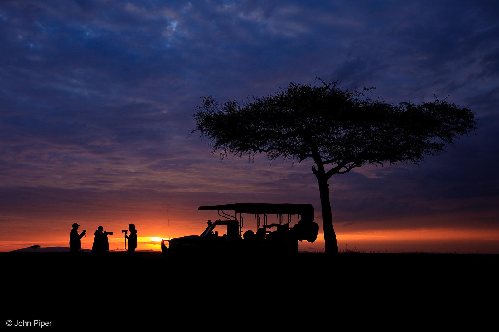 The essence of a safari, set against a magical African sunrise. Mara North Conservancy, Kenya © John Piper